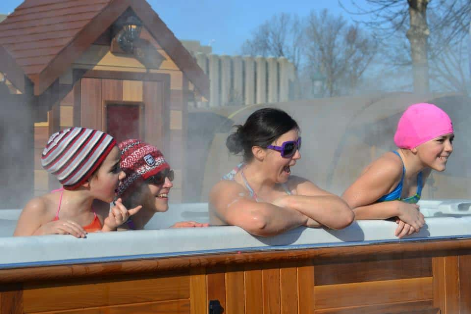 People in a hot tub at the arctic spas quebec carnival