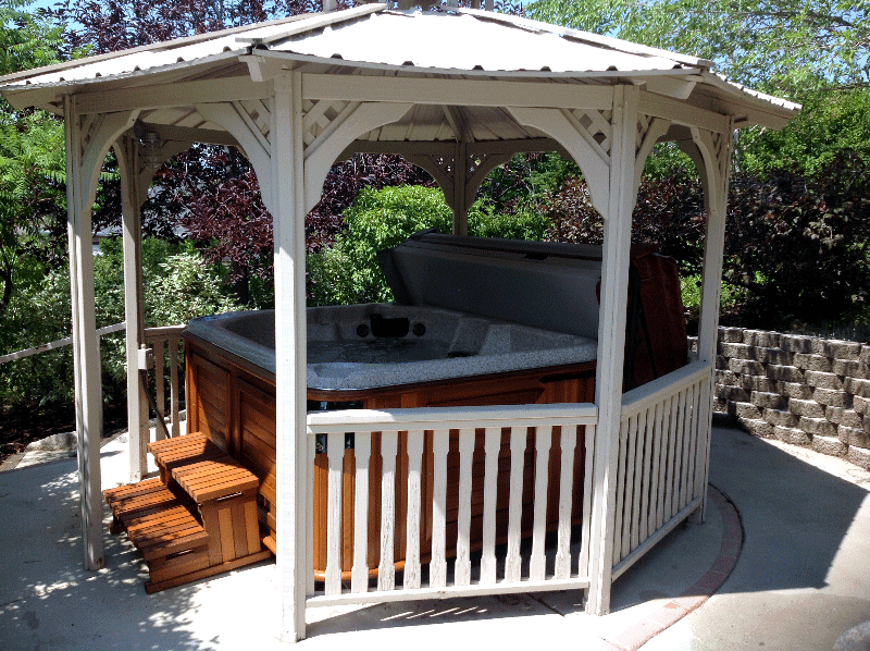 Arctic Spas hot tub on patio covered with gazebo