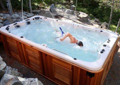 A man swimming in a swim spa